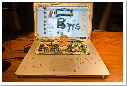 Between the Lines Blog 8th Birthday, made my computer in a a frosted cake with lit candle.