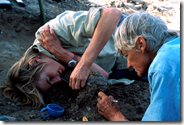Dr. Louise Leakey and her mother Dr. Meave Leakey cleaning a speciment in the field