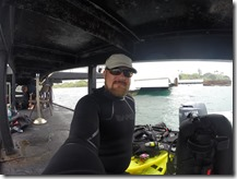 Capturing the USS Arizona in 3D Project - Shaan Hurley under the USS Arizona Memorial Dock in Wetsuit