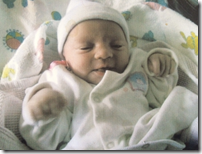Katie as a beautiful baby girl on the day she was born.