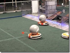 iRobots cleaning the FIRST play field