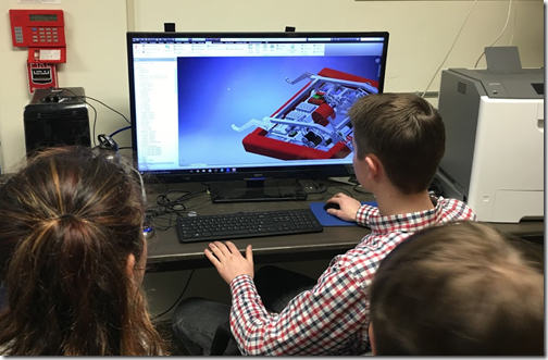 Students using Autodesk Inventor to design a robot.