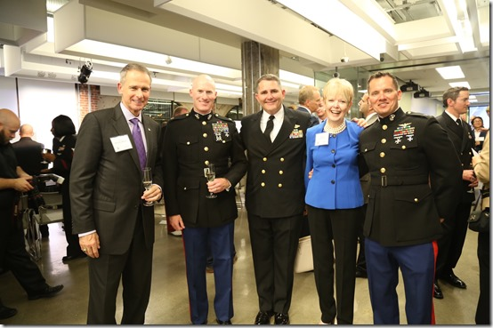 General Peter Pace with his wife Lynn Pace (center) who is the official sponsor of the USS America LHA-6 and some active duty Marines and an honored guest.
