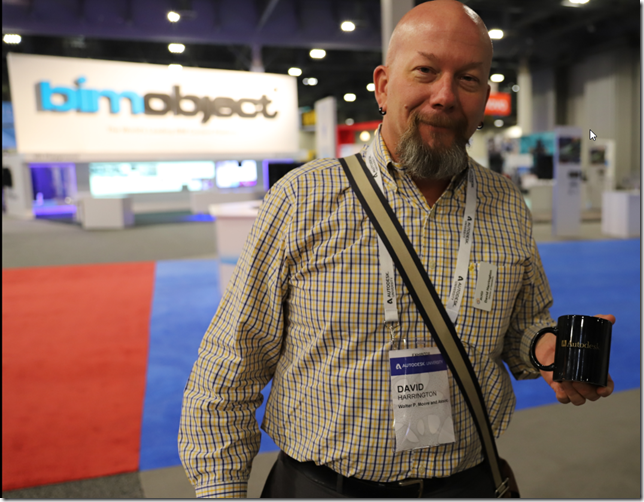 David Harrington giving an old Autodesk coffee mug.