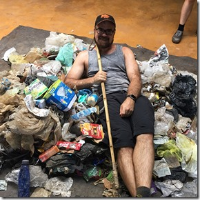 Shaan (me) in a pile of collected garbage in Bali Indonesia, primarilyy plastic