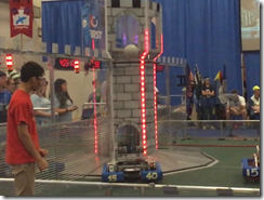 slow motion video of a successful shot at the tower by Team 1540's robot