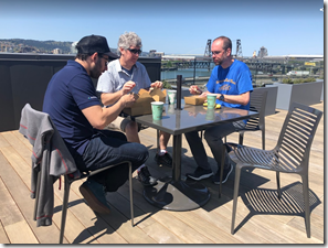 Employees eating lunch on the deck.