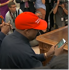 Kanye unlocking his phone in front of media -ALL ZEROS!